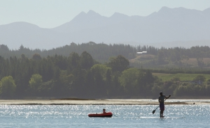 Paddleboarder and child