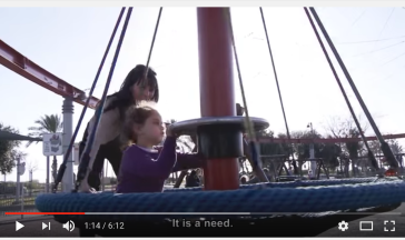 mom and kid on sn swing
